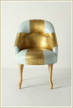 Anthropologie  a chair with leather and gold, could renew my black leather sofa and give im some punch