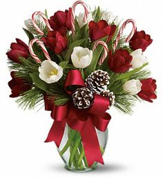Here's the perfect hostess gift - By Golly It's Jolly - a beautiful Christmas bouquet of bright red and white tulips, real candy canes, pinecones and holiday greens in a pretty ginger vase with a holiday bow. Christmas Flower Decorations, Christmas Flower Arrangements, Christmas Flowers, Christmas Centerpieces, All Things Christmas, Christmas Holidays, Christmas Wreaths, Christmas Gifts, Merry Christmas