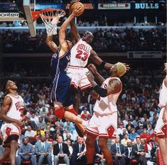 Michael Jordan rejects the New Jersey Nets' Chris Gatling at the rim in Game 1 of an Eastern Conference playoffs first-round series in 1998. With Jordan scoring 32 or more points in each game, the Bulls made quick work of the Nets, eliminating them in three games.