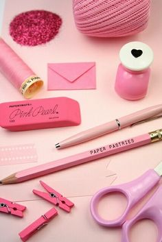 Pink home office work desk stationery display scissors rubber pencil