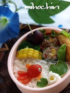 Red fish in a bento box. Made with a cherry tomato, it is really nice :)