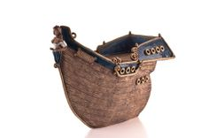 pottery boat with buxom figurehead - click for a larger image