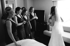 Boston Exchange Conference Center Fish Pier Wedding - Boston, MA | Shane Godfrey Photography The #Bride showing her #weddinggown to her #bridesmaids #BostonWeddingPhotographers #BostonWeddingPhotography #BostonBridal #BostonWeddings
