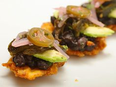 FRIED PLANTAINS WITH BLACK BEANS, ROASTED POBLANOS, AVOCADO, AND PICKLED RED ONION