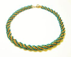 Gold and Green African Helix Necklace by kiddercreations on Etsy, $40.00