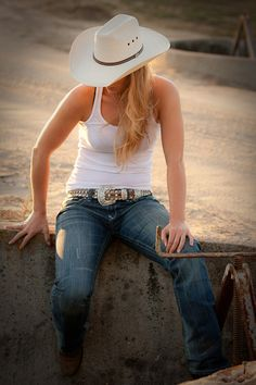 cowgirl on fence.