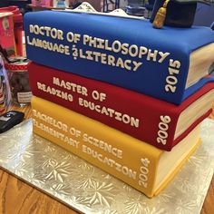 """Tarika Saada – It's like my résumé…but on a cake. Each """"book"""" represents a university I've attended. Gold for Oakwood University! Maroon for Alabama A & M! Royal blue for Georgia State! I absolutely love this! Oakwood University, Georgia State University, Phd Graduation, Graduation Gifts, Graduation Ideas, Graduation Cupcakes, Alabama, Doctor Party, Cake Pops"""