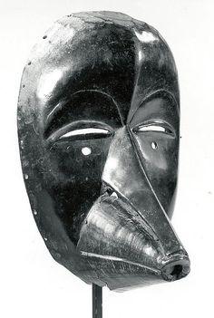 Face Mask Date: 19th–20th century Geography: Côte d'Ivoire, western Côte d'Ivoire Culture: Dan peoples Medium: Wood, hide with fur, fiber, iron, metal Dimensions: H. 8 3/4 x W. 5 5/8 x D. 5 1/8 in. (22.2 x 14.3 x 13 cm)