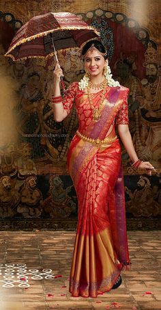 53f1f5bc053cc South Indian Bride wearing Silk Saree and Holding the Umbrella.