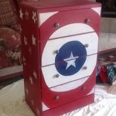 Captain America Dresser.  Red with white stars, shield on front, white stamp stars, silver star knobs.