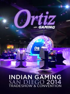 (San Diego, CA - May 13, 2014) - Without a doubt Ortiz Gaming lights up the National Indian Gaming Association floor with a neon glowing purple display. Ortiz Gaming's booth presents a hi-tech futuristic display that truly reflects the company's offerings of games and products. The Ortiz Gaming booth premieres their 2014 collection of games under a stunning glow of dancing purple lights with an eye catching tower of Ortiz Gaming's logo over the booth's video wall.