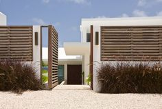 Nice front fence detail of solid and void. Villa Kishti in Anguilla