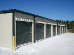 Renegade Steel Buildings self storage mini warehouse. Tan metal building with green trim and roll up doors. Renegade Steel Buildings self storage mini warehouse. Tan metal building with green trim and roll up doors. Side Hinged Garage Doors, Wooden Garage Doors, Garage Door Design, Self Storage, Built In Storage, Storage Units, Storage Room, Building Systems, Building Design