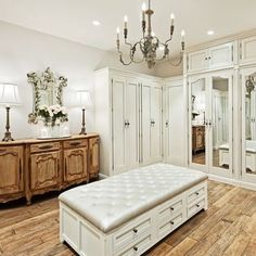 Creamy walls, fantastic flooring & one gorgeous sideboard table make this dressing room a classic...not to mention the multi-versatile tufted ottoman!