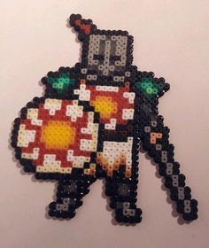 PRAISE THE SUN!!  Available as plain sprite or as fridge magnet.  Individually hand crafted with hama beads by myself so may not be identical. Whilst durable, please take care with all items  Please allow 3 days to make (Please note sometimes I may be short on specific colours and will need to restock, at which point I will provide a small discount for the inconvenience of longer production period)  FREE 1ST CLASS DELIVERY to UK Mainland. Standard and Economy options for International.