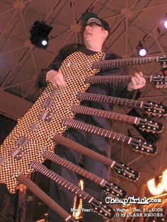 Rick Nielsen of Cheap Trick and his 9-necked guitar.