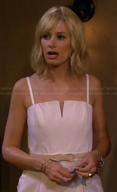Caroline's white split neck jumpsuit on 2 Broke Girls.  Outfit Details: http://wornontv.net/41884/ #2BrokeGirls