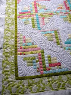 Jenny's Doodling Needle: Even quilt spacing and feathers.