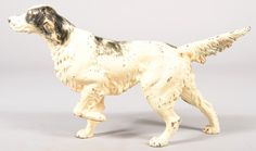 "Sold For $ 120    Large Black on White Hubley Setter Dog Doorstop. 15 1/2""l. Condition: Good with use wear."