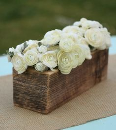 Wood Planter Boxes with a single colour flower. just beautiful for a simple table arrangement or garden decoration.