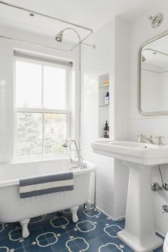 Bathroom with salvaged tub and Waterworks sink in Brooklyn renovation by Elizabeth Roberts.
