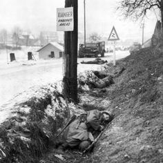 Four American sodiers lie dead along a Belgian road during the Battle of the Bulge - December 1944.