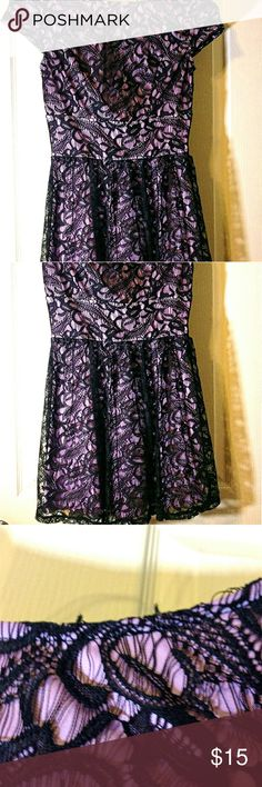 Beautiful pink and black lace dress! This is a beautiful, cute pink and black lace dress! The lace pattern is flower in a way! This dress is a little short and thier is also from lose threads in some areas (I have pictures of it above) but they aren't really noticable. Dresses Mini