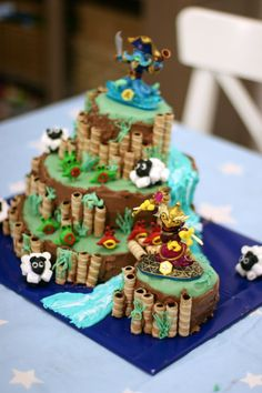 Skylander Birthday Cake! Features 4 levels - river, bridge, sheep, and chompies. So cool!
