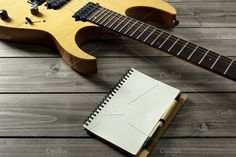 Guitar on Wooden Top & Paper Notepad by NikoKolev on @creativemarket