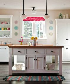 ~ I love the whites with the pop of color.  I spy my IKEA pitchers on the cabinets too.  Poppytalk: A Happy Kitchen