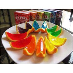 Rainbow jelly in oranges segments, great idea for kids birthday parties