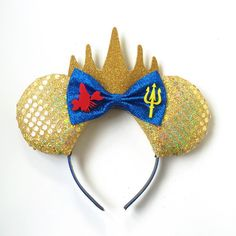 A personal favorite from my Etsy shop https://www.etsy.com/listing/259845794/king-triton-ears-king-triton-mickey-ears