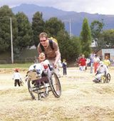 Decide If  VolunTourism --  Volunteer Travel -- Is For You : Justin Croteau of Pittsburgh takes part in wheelchair races while volunteering in Quito, Ecuador
