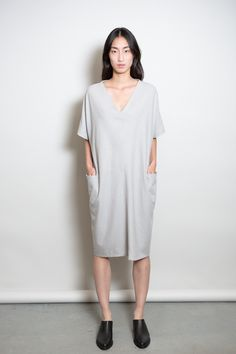 A functional yet elegant dress that you can wear year round and great for layering, designed in collaboration with MAD. Silk noil, 3/4 length drop-sleeves, a...