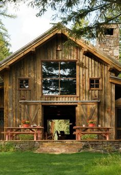 This striking old timber frame rustic-modern barn is built from the reclaimed wood of older structures by RMT Architecture near the Swan Mountain Range in Montana. Pole Barn House Plans, Pole Barn Homes, Barn Plans, Pole Barn Kits, Modern Barn, Modern Rustic, Modern Farmhouse, Farmhouse Ideas, Metal Building Homes