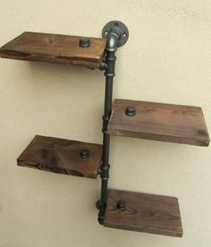 Add industrial chic to your home. Combining iron pipes and wooden shelves it makes a sturdy wall storage, which is suitable for anywhere around the house. 50 Easy Urban Industrial Decor plans To Accent Your Brick & Steel City Digs Rustic Industrial Furniture, Industrial Design Furniture, Vintage Industrial Furniture, Pipe Furniture, Industrial House, Furniture Projects, Industrial Chic, Furniture Design, Modern Furniture