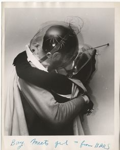 1950s Retro Couple Kissing With Martian Helmets | Retro 1940s Spaceman | Vintage Black and White Photography | 1930s Costume Ideas
