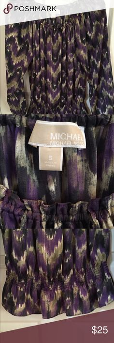 Beautiful Michael Kors Blouse Michael Kors Blouse can be worn so many ways-dressy, casual, fits loose and flowy up top and comes in around waist..elastic at bottom of sleeves..silky material but 100% polyester..like-new condition-awesome colors too! MICHAEL Michael Kors Tops Blouses