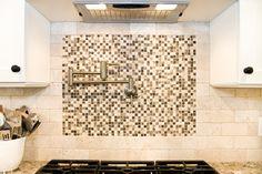 mosaic tile backing behing pot-filler.