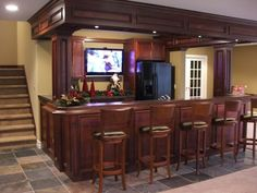 Our finished basement Bar Fireplace idea Like the room set