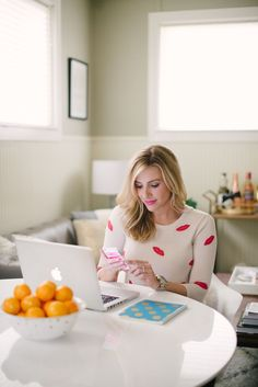 """Love the """"bowl of fruit in front while working on laptop"""" look."""
