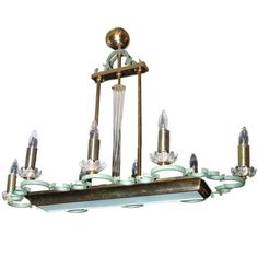 "An Art Deco Baccarat (signed) eight arm brass fixture,  painted metal with glass cups. CIRCA: 1935 DIMENSIONS: 28"" h x 37"" w x 18"" d"