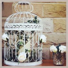 Bird cage of ivy and roses