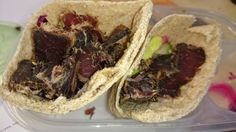 Wholemeal pita bread with lean biltong and salad