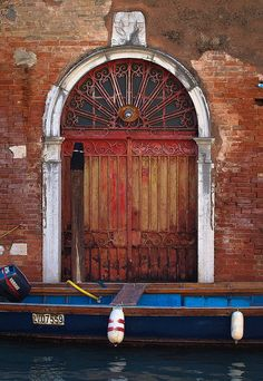 Venice.  These you see from the gondola. Actually the doorway to their homes.