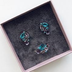 sterling silver jewelry set with bright colored crystals