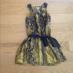 Ted Baker Silk Printed Dress  Navy and yellow silk printed dress. Adorable and easy to wear. Love it but only wore it twice. Comes with a navy silk belt and zipper on the side. Needs to be steamed to remove wrinkles  this a size  2 in ted baker size which is equivalent to a 6 american size. Ted Baker Dresses
