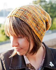 This simple stockinette hat was inspired by the warm and cozy colors of the Koigu Kertsi merino yarn used in the pictures. The brilliant yellows and oranges of changing leaves and the dark grays of chilly nights all asked to be knit into a comfy, slouchy fall hat. So, knit this up and wear it on all of your pumpkin picking, hot cider drinking, hay riding autumn adventures. Since this pattern is so simple, it's great for people just starting to spread their knitting wings. Perfect your basic…
