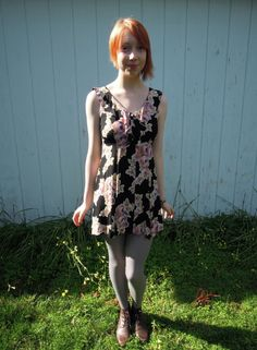 Stunning Betsey Johnson mini dress with a ruffle collar that ties in the middle, and a large rose print with a black background. It kills me to sell this, it is my favorite dress! But it no longer fits. It buttons down the front, and ties in the back. 100% rayon, dry clean only.   Measurements taken flat:   Bust: 13 1/2 inches   Length from shoulder to bottom: 31 inches  $49