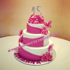 Drapes and roses Quinceanera cake.